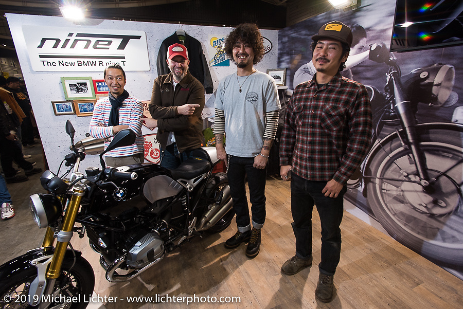 Japanese custom builders with BMW's head of motorcycle design Ola Stenegard at the unveiling of custom BMW's during the Annual Mooneyes Yokohama Hot Rod and Custom Show. Japan. Sunday, December 7, 2014. Photograph ©2014 Michael Lichter.