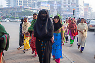 Garment workers walking to work in Dhaka Bangladesh