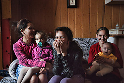 "Lucie Danková, 26, and daughter Kristinka Danková, 2, laugh with sisters with Sára Danková, 12, Nina Danková, 18, Santyjago Danko, 5 months, inside their home in Ostrava, Czech Republic on March 2, 2012. The girls' brother Peter Danko was one of 18 Roma children who were represented in the D.H. and Others v. Czech Republic case, the first challenge to systemic racial segregation in education to reach the European Court of Human Rights. When this case was first brought in 2000, Roma children in the Czech Republic were 27 times more likely to be placed in ""special schools,"" intended for the mentally disabled, than non-Roma children. In 2007, the Grand Chamber of the European Court of Human Rights ruled that this pattern of segregation violated nondiscrimination protections in the European Convention on Human Rights. Despite this landmark decision, little change has occurred: the ""special schools"" have been renamed but follow the same substandard curriculum and Roma continue to be assigned to these schools in disproportionate numbers. The process of integration has barely begun."