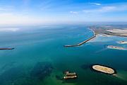 Nederland, Zeeland, Gemeente Schouwen-Duiveland, 01-04-2016; Haven van Schelphoek, ten zuiden van Serooskerke, gebruikt als werkhaven bij de bouw van de Oosterscheldekering. In de haven drie caissons.<br /> Remnants of temporary port for the construction of Oosterschelde storm surge barrier, south of Serooskerke.<br /> <br /> luchtfoto (toeslag op standard tarieven);<br /> aerial photo (additional fee required);<br /> copyright foto/photo Siebe Swart