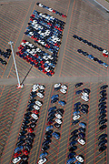 Nederland, Limburg, Gemeente Sittard-Geleen, 07-03-2010; parkeerterrein (depot) bij NedCar met nieuwe in born voor door Mitsubishi geproduceerde auto's.Parking (depot) at NedCar with new cars produced for Mitsubishi.luchtfoto (toeslag), aerial photo (additional fee required).foto/photo Siebe Swart