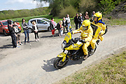 France, April 13th 2014: The motorbike that informs riders of time gaps passes  Pont Gibus, Wallers, during the 2014 edition of the Paris Roubaix cycle race.