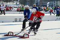 Night Owls Joe Capraro and Ice Sages Mike O'Leary take to the ice Friday morning for their first game of the 50+ Open division in the New England Pond Hockey Classic on Meredith Bay.  (Karen Bobotas/for the Laconia Daily Sun)