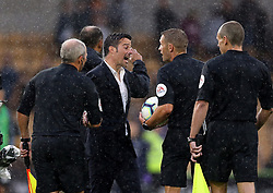 Everton's manager Marco Silva has words with the match officials during the match at Molineux
