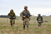 © Licensed to London News Pictures. 09/03/2012. Copedown Hill, UK.  Soldiers on a patrol exercise. Secretary of Defence Philip Hammond visits troops during the day. The 12th Mechanized Brigade (12 Mech Bde) at Copehill Down, Salisbury Plain Training Area, Wiltshire, on FRIDAY 09 MARCH 2012, as it prepares to deploy to Helmand Province, Afghanistan, on Operation Herrick 16, in the Spring of this year. The Brigade were performing a dynamic demonstration of combined Afghan/ISAF operations supported by surveillance assets and casualty evacuation capability. Tornado GR4 fast jest ground support was also displayed.. Photo credit : Stephen SImpson/LNP