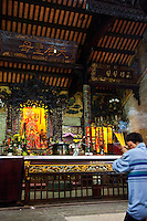 Worshippers make offerings of incense at Tian Hou Temple in Saigon.