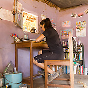 Rachael, a Pace Corps volunteer from the USA, has made this Koumbadiouma hut her home, taking great care to personalise her space. Kolda, Senegal.