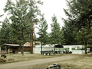 Attached sheds, a trailer, and a camper