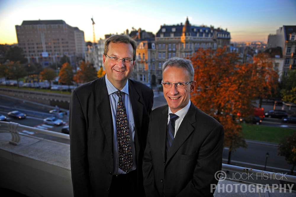 Mats Nilsson, Vice President of Ericsson's European Affairs Office, left, and Magnus Madfors, Director of R&D policy, on their office terrace in Brussels, Belgium.<br /> Client: Ericsson Contact Magazine