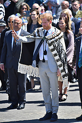 The Duke of Sussex lifts a Maori dagger as he is greeted with haka, at Te Papaiouru, Ohinemutu, in Rotorua, New Zealand, before a lunch in honour of Harry and Meghan, on day four of the royal couple's tour of New Zealand.