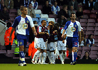 Photo: Olly Greenwood.<br />West Ham United v Blackburn Rovers. The Barclays Premiership. 29/10/2006. West Ham's Teddy Sheringham celebrates scoring with his team mates while Blackburn players look dejected