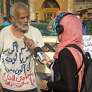 Interviewing protester Magdy Iskander on his hopes and visions for the future in Tahrir Square. Cairo, Egypt.