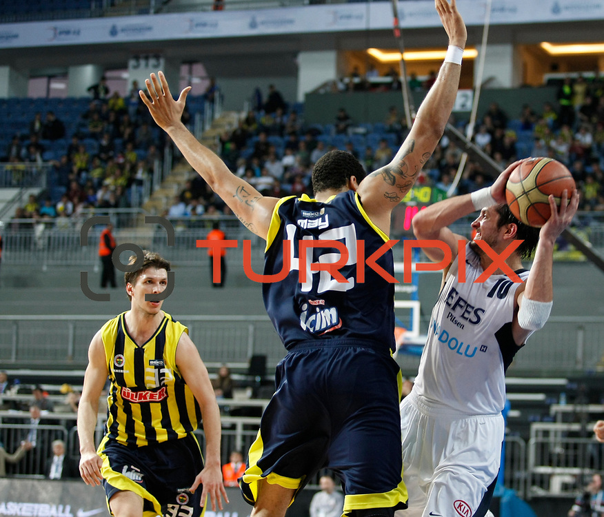 Efes Pilsen's Kerem TUNCERI (R) and Fenerbahce Ulker's Marko TOMAS (L) during their Turkish Basketball league derby match Efes Pilsen between Fenerbahce Ulker at the Sinan Erdem Arena in Istanbul Turkey on Sunday 24 April 2011. Photo by TURKPIX