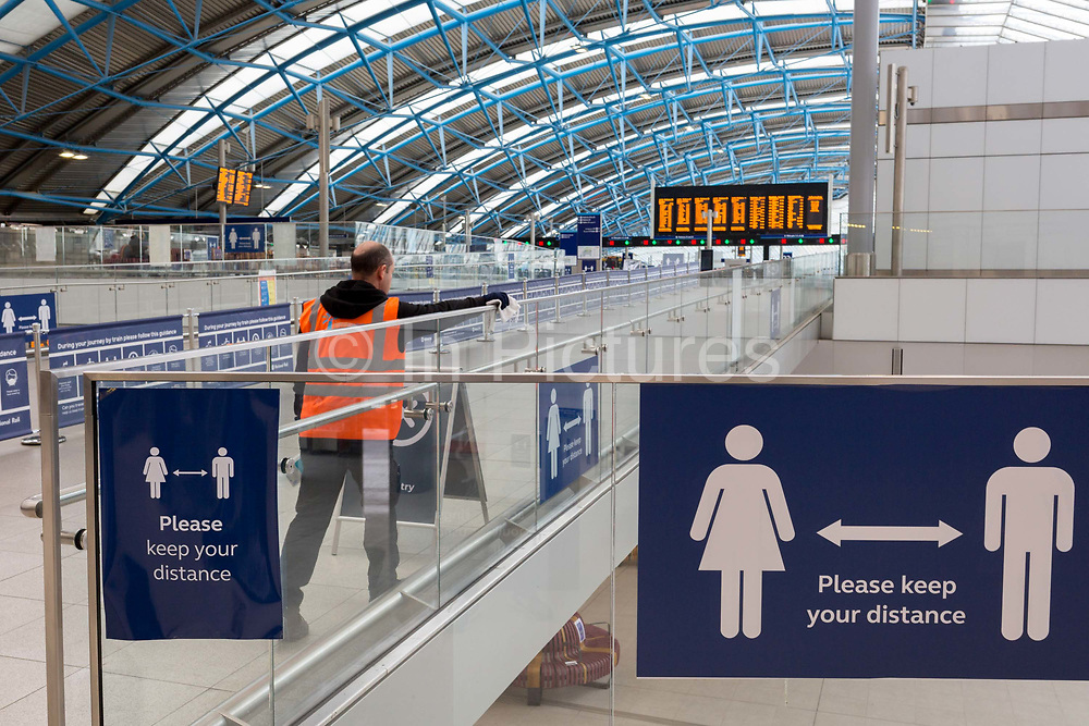 With the UKs Coronavirus pandemic lockdown easing with preparations going ahead for the opening of more public transport and services plus shops, another 151 have died from Covid-19 bringing the total in the last 24hrs to 41,279. An employer at Waterloo Station disinfects surfaces in the station concourse, on 11th June 2020, in London, England.