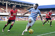 Charlie Austin of QPR keeping the ball in play while Jonny Evans of Manchester United is chasing. Barclays Premier league match, Queens Park Rangers v Manchester Utd at Loftus Road in London on Saturday 17th Jan 2015. pic by John Patrick Fletcher, Andrew Orchard sports photography.