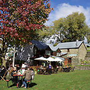 Buckingham Green in Arrowtown main street during Autumn..Arrowtown is the much visited, historic, 4-season, southern hemisphere holiday destination, located only 20 minutes drive from Queenstown, South Island, New Zealand..Arrowtown is a former gold-mining town built on the banks of the Arrow River, once a rich source of gold in the 1860's and now a sophisticated, multi-cultural town catering visitors from around the globe. Arrowtown offers an ambiance with its shops, restaurants, cafes, offices and galleries located within a tight precinct.  5th April 2011.  Photo Tim Clayton.