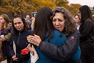 """27 OCT. 2018 -- ST. LOUIS -- Risa Zwerling (right), wife of Washington University Chancellor Mark S. Wrighton, greets Chana R. Novack of WashU Chabad before members of the Washington University in St. Louis community gathered on campus for a """"Unity Gathering & Tree-Planting"""" Wednesday, Oct. 31, 2018 in St. Louis. The event was organized by the WU Center for Diversity & Inclusion and WU Interfaith Campus Ministries in response to the killing of members of the Jewish community in Pittsburgh Oct. 27. Photo by Sid Hastings, copyright 2018 Washington University."""