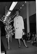 09/03/1964<br /> 03/09/1964<br /> 09 March 1964<br /> McBirney's Fashion show at McBirney's, Aston Quay, Dublin. Model Blanche showing a white coat from the collection.