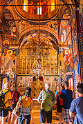 Visitors and docent in the abbey chapel, Krka Monastery, Krka National Park, Dalmatia, Croatia