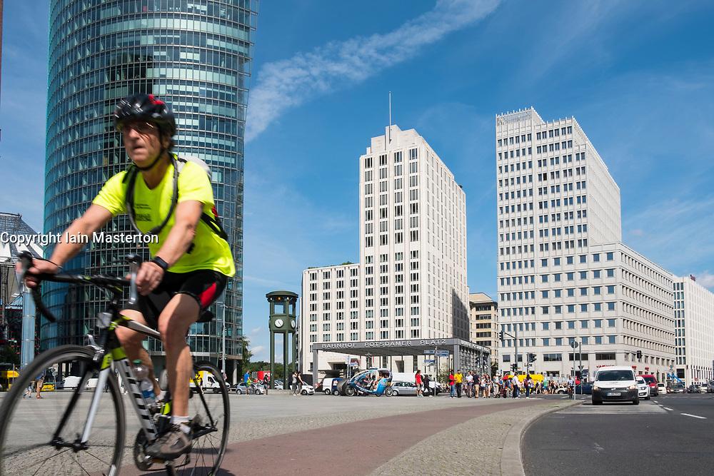 Cyclist in Potsdamer Platz on cycle way in Berlin , Germany