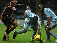 Photo: Ian Hebden.<br />Coventry City v Wolverhampton Wanderers. Coca Cola Championship. 02/01/2006.<br />L to R wolves' Leon Clarke with Stern John (C) and Dele Adebola of Coventry.
