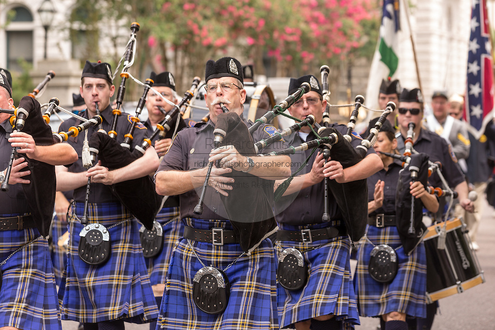 Members of the Charleston Police Pipes and Drums march down Meeting Street to celebrate Carolina Day June 28, 2014 in Charleston, SC. Carolina Day celebrates the 238th anniversary of the American victory at the Battle of Sullivan's Island over the Royal Navy and the British Army.