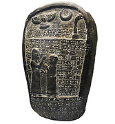 Boundary stone.  This document records the services of Ritti-Marduk, commander of the chariots, in a royal campaign against Elam in south Iran.  As a reward his ancestral territory was made exempt of taxation.  From the Reign of Neburchadnezzar 1 (1125-1104 BC).