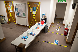 © Licensed to London News Pictures . 11/09/2020. Bolton , UK . Coronavirus prevention measures inside Devonshire Education Centre and mosque . Police officers from Greater Manchester Police and Environmental Health Officers from Bolton Council respond to concerns of breaches of Coronavirus regulations , as stricter lockdown measures and a curfew on hospitality businesses are imposed in the borough to limit the spread of Covid-19 . Photo credit : Joel Goodman/LNP