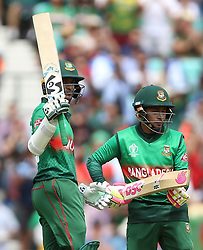 Bangladesh's Shakib Al Hasan (left) reaches his half century during the ICC Cricket World Cup group stage match at The Oval, London.