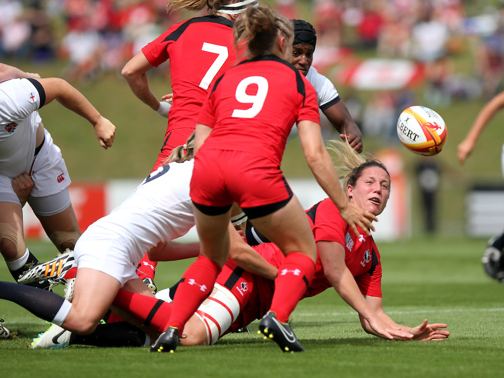 Kelly Russell passes the ball. England v Canada Pool A match at WRWC 2014 at Centre National de Rugby, Marcoussis, France, on 9th August 2014