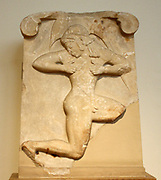 Relief plaque, Parian marble found in Athens, near Theseion. It most probably belonged to the facing of a funerary monument.  It represents a naked youth with a helmet running to right.  He may be an athlete participating in the hoplite race or a pyrrhic dancer.  The work is remarkable for the bold rendering of motion and for the figure's coordination with the shape of the plaque, about 500 BC.