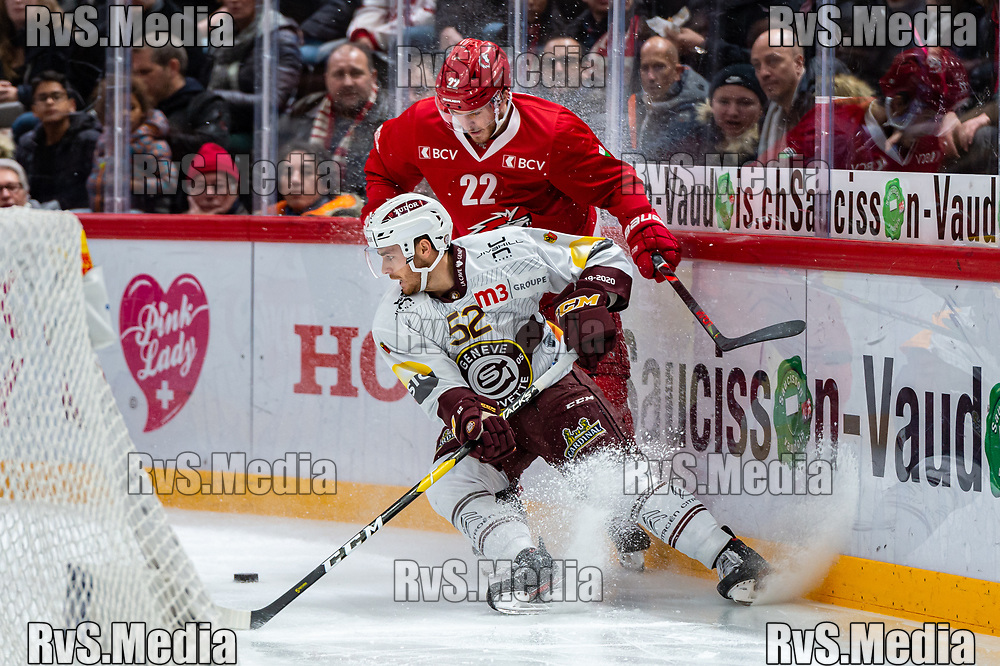 LAUSANNE, SWITZERLAND - NOVEMBER 23: #22 Christoph Bertschy of Lausanne HC battles for the puck with #52 Mike Vollmin of Geneve-Servette HC during the Swiss National League game between Lausanne HC and Geneve-Servette HC at Vaudoise Arena on November 23, 2019 in Lausanne, Switzerland. (Photo by Monika Majer/RvS.Media)