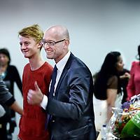 Nederland, Amsterdam , 16 oktober 2012..Tjeerd Herrema de nieuwe stadsdeelvoorzitter van Zuidoost wordt gefeliciteerd op het Stadsdeelkantoor Zuid Oost bij Anton de Komplein..links zijn 2 zonen..Foto:Jean-Pierre Jans