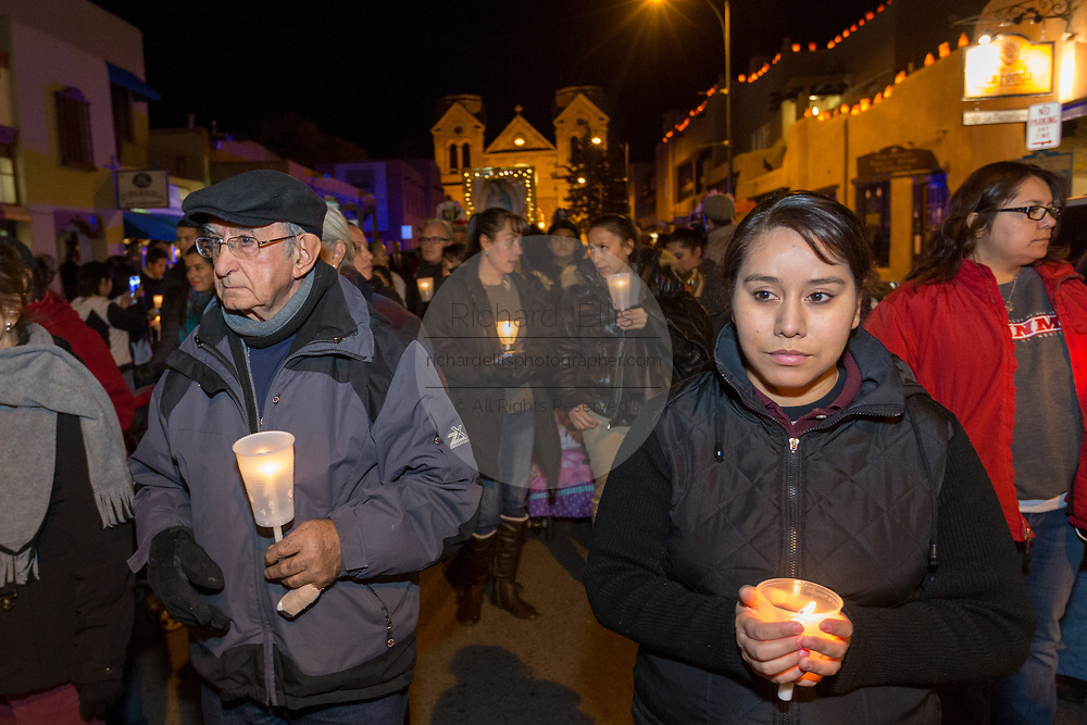 Catholic faithful during a candle light procession from the Cathedral Basilica of St. Francis of Assisi celebrating our Lady of Guadalupe December 11, 2015 in Santa Fe, New Mexico. Guadalupanos as the devotees are known, celebrate the apparitions of the Virgin Mary to an Aztec peasant at Tepeyac, Mexico in 1531.