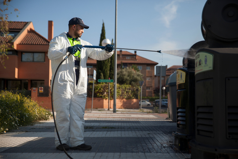 MADRID, SPAIN - April 14, 2020: An city contractor employee sprays pressurized ozone to desinfect trash containers on the street on April 13, 2020 in Majadahonda, Madrid, Spain, during the COVID knowdown. More than 15,000 people are reported to have died in Spain due to the COVID-19 outbreak, although the country has reported a decline in the daily number of deaths. (Photo by Miguel Pereira/Getty Images)