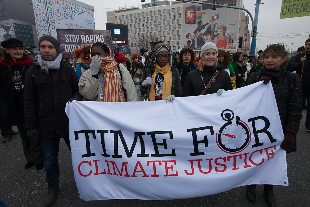 ACT Alliance brought a banner saying Time for Climate Justice during the march for Climate and Social Justice at COP19, UN climate change conference in Warsaw, Poland