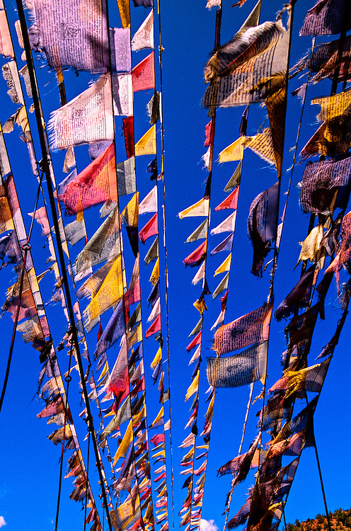 Prayer flags on footbridge, Paro Valley, Bhutan