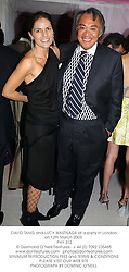 DAVID TANG and LUCY WASTNAGE at a party in London on 12th March 2003.	<br />