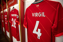 LIVERPOOL, ENGLAND - Thursday, August 5, 2021: Liverpool players' shirts, including Virgil van Dijk, hanging in the dressing room at Anfield on display as part of the official stadium tour. (Pic by David Rawcliffe/Propaganda)