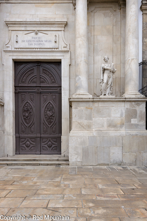 Porto, Portugal - February 13, 2018 - 'Pavete ad sanctuarium meum. ego dominus.', outside the Igreja da Ordem Terceira de São Francisco (Church of the Third Order of St. Francis), Leviticus 26:2 is inscribed in Latin above the Church's door. With an outstanding 2,000 year history, the entire Historic Centre of Oporto is classified as a National Monument. <br /> <br /> Image: © Rod Mountain<br /> <br /> http://www.rodmountain.com<br /> <br /> @visitportugal @VOTSFP @visitporto.portal @TurismoPortoNortePortugal @TurismodePortugal<br /> <br /> #CantSkipPortugal #tourismportugal #portugal #visitportugal #culturaportugesa #turismoemportugal #turismo #rotaportugal #Porto #Church #architecture #Historic #design #art #bnw_universe #insta_bw #bwstyleoftheday#noir_vision #jj_blackwhite #bwsquare #getlost#theworldshotz #createexplore #exploretocreate #VirtuosoTravel #bestplacestogo #Europe<br /> <br /> #NikonCA #NikonNoFilter #NikonEurope<br /> Nikon D800 / Nikkor Lens @nikoncanada @nikoneurope <br /> <br /> Church of São Francisco<br /> https://en.wikipedia.org/wiki/Church_of_São_Francisco_(Porto)<br /> http://ordemsaofrancisco.pt/en/<br /> https://en.wikipedia.org/wiki/Porto<br /> https://www.visitportugal.com/en<br /> https://en.wikipedia.org/wiki/Portugal<br /> http://www.portoenorte.pt/en/