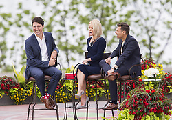 Prime Minister Justin Trudeau, left, speaks with Kelly Ripa, centre, and Ryan Seacrest during his appearance on Live with Kelly and Ryan in Niagara Falls, Ontario on Monday, June 5, 2017. Photo by Aaron Lynett/CP/ABACAPRESS.COM    595507_008 Niagara Falls Canada