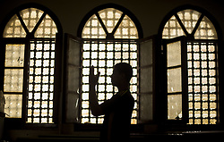 June 18, 2017 - Gaza City, The Gaza Strip, Palestine - A Palestinian man prays in the Al-Omari mosque during the Muslim holy month of Ramadan, in Gaza City, Gaza Strip,18 June 2017. Muslims around the world celebrate the holy month of Ramadan by praying during the night time and abstaining from eating, drinking, and sexual acts daily between sunrise and sunset. Ramadan is the ninth month in the Islamic calendar and it is believed that the Koran??8??s first verse was revealed during its last 10 nights. (Credit Image: © Mahmoud Issa/Quds Net News via ZUMA Wire)