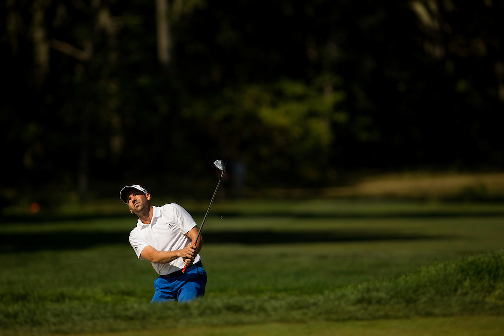 FARMINGDALE, NY - AUGUST 26:  Sergio Garcia of Spain plays an approach shot during the final round of the 2012 Barclays at the Black Course at Bethpage State Park in Farmingale, New York on August 26, 2012. (Photograph ©2012 Darren Carroll) *** Local Caption *** Sergio Garcia