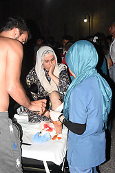 July 21, 2017 - Mugla, Turkey - People receive medical treatment at the garden of Bodrum State Hospital following an earthquake, in the Agean coastal city of Mugla. A strong 6.7 magnitude earthquake hit Turkey's Aegean coast, and at least 90 people were injured as a sea surge caused damages in buildings and streets. Two people were killed and dozens were injured on the Greek Island of Kos and beachfront hotels have been flooded on both Turkish and Greek coasts after the earthquake hit in the Aegean Sea. (Credit Image: © Dha/Depo Photos via ZUMA Wire)