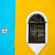 Window on a colourful Spanish Colonial house in Puebla, Mexico