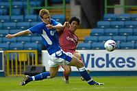 Photo: Daniel Hambury.<br />Millwall v Reading. Pre Season Friendly. 27/06/2006.<br />Reading's Seol Ki-Hyeon gets a cross in past Millwall's Paul Robinson.