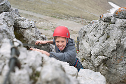 Boy helmet mountains climbing Alps cliff