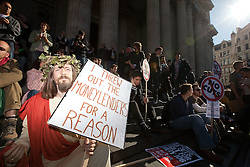 © Licensed to London News Pictures. 15/10/2011. London, UK. A man dressed as Jesus Christ sits on the steps in front of St Paul's Cathedral. Protesters, angry at cuts and the banks, mass outside St Paul's Cathedral following a call to occupy the London Stock Exchange. Photo credit : Joel Goodman/LNP