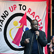 Speaker  Weyman Bennett rally of a UN Anti-Racism Day Demonstration and march of  the horrific Islamophobic terrorist attack on a mosque in Christchurch, New Zealand, that has left 49 dead on 16 March 2019, opposite Downing Street, London, UK.