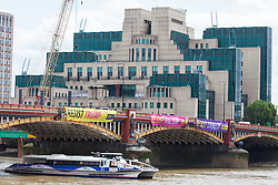 London, UK. 3 June, 2019. Three of five brightly-coloured banners bearing the slogans 'Resist Trump', 'Resist sexism', 'Resist racism', 'Resist hate' and 'Resist cruelty' are dropped on Vauxhall Bridge in view of the US embassy by activists from Amnesty International at the beginning of President Donald Trump's three-day state visit to the UK. Amnesty International has written to Prime Minister Theresa May has written to Theresa May to urge her to raise human rights issues directly with the US President.